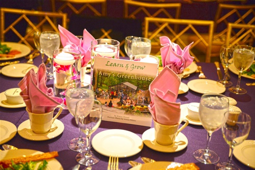 Learn & Grow Amy's Greenhouse book, placed in center of the tables at gala dinner event